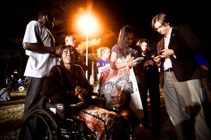 At 11:08 pm, at the exact minute that Troy Davis died, Martina Correia brings a young college student over to Laura Moye (right) to sign up to get involved with Amnesty International. While the student writes down her contact information, Martina gazes toward the prison, not knowing that in that very moment, Troy is gone.